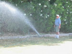 a Folsom sprinkler repair contractor checks a pop up head spray angle